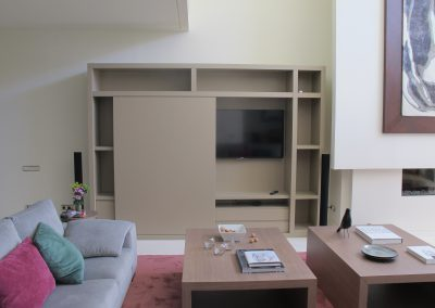 Furniture with sliding door to hide TV